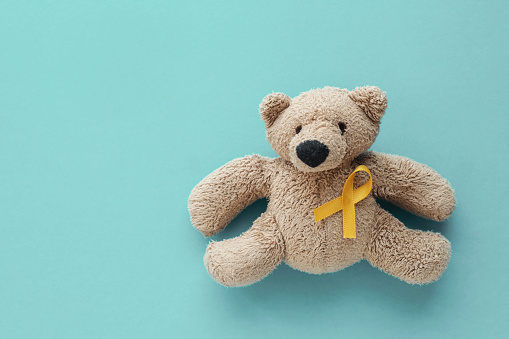 Children soft toy brown bear with yellow gold ribbon, Childhood cancer awareness