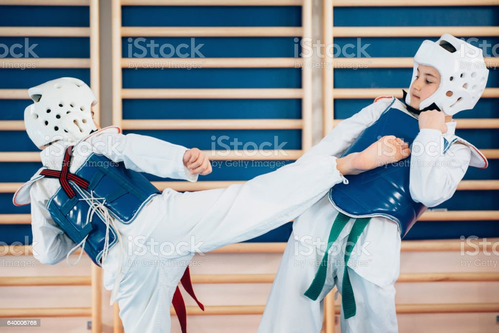 Children sparing in tae kwon do stock photo