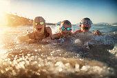 Kids playing on beach on sunny summer day.\nNikon D850
