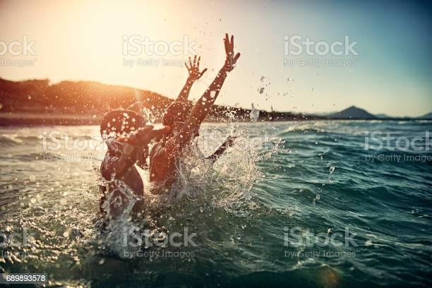 Children splashing in summer sea picture id689893578?b=1&k=6&m=689893578&s=612x612&h=6sx j1j3vn qfbf2 ijuhjpv lrfd9xvhh tm9d0jme=