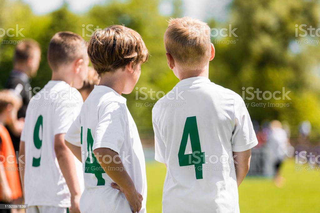 Children Sports Team Members. Junior Soccer Players on Substitution...