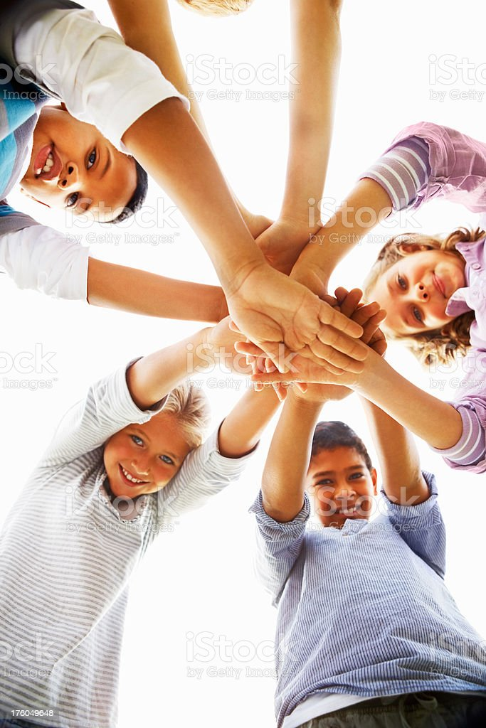 Children stacking their hands together royalty-free stock photo