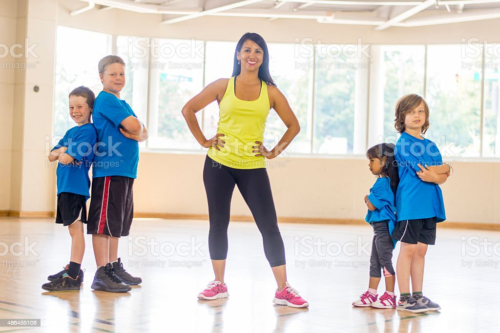 Children Standing in a Gym stock photo