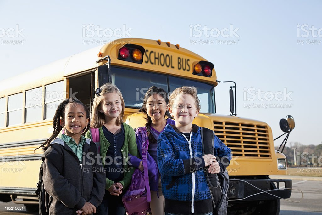 Children standing outside school bus royalty-free stock photo