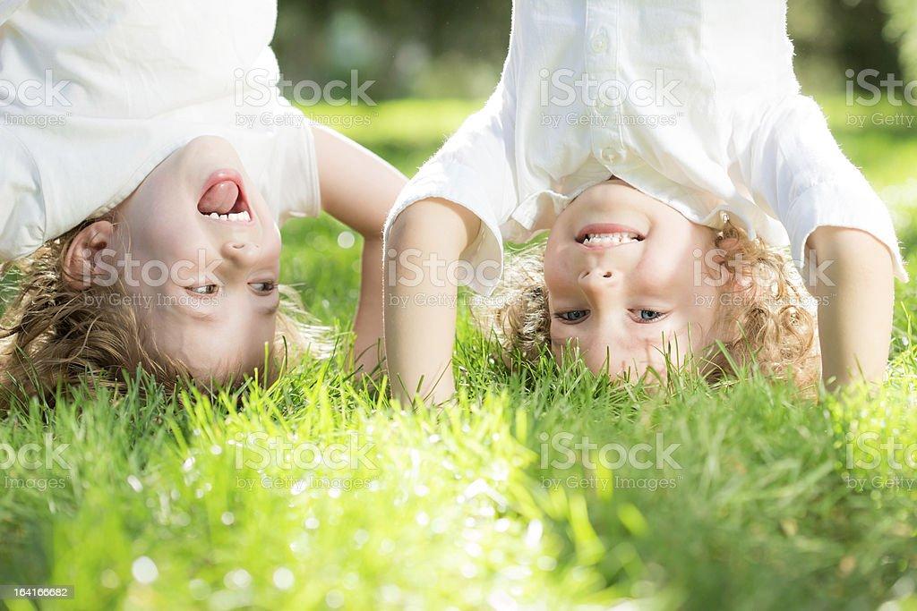 Children standing upside down stock photo