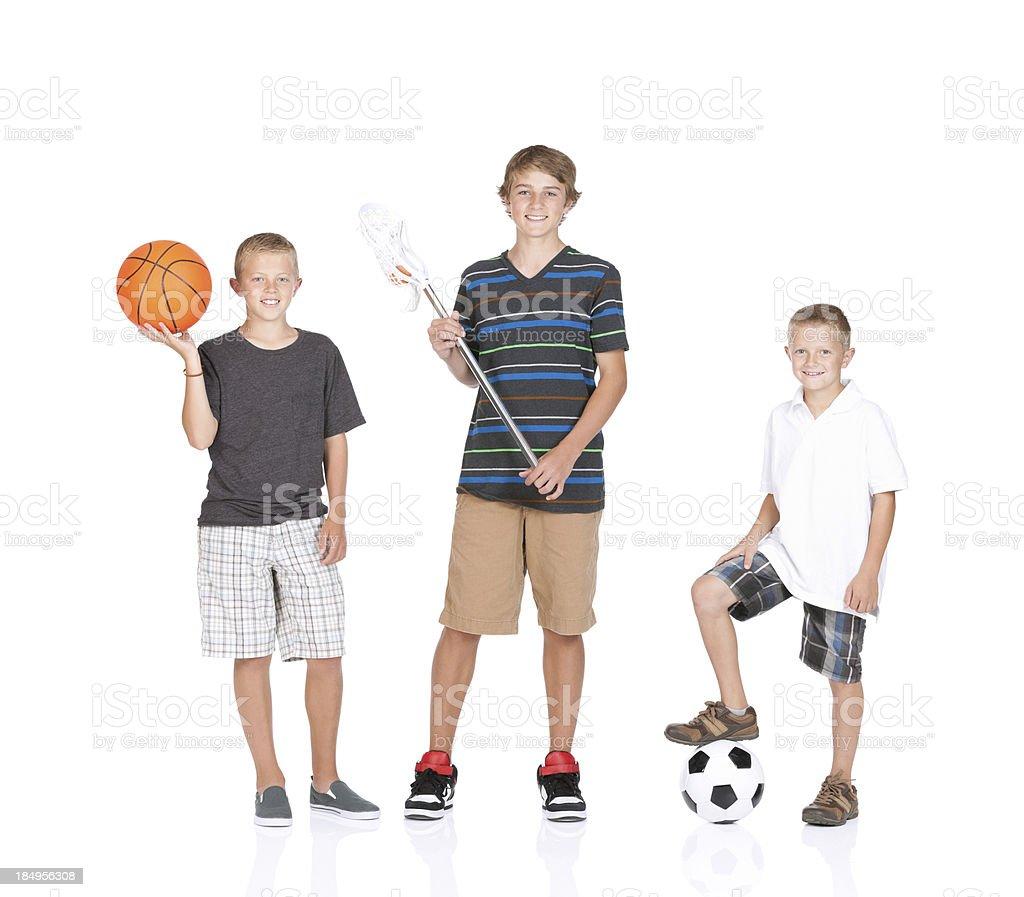 Children standing with sports equipment stock photo