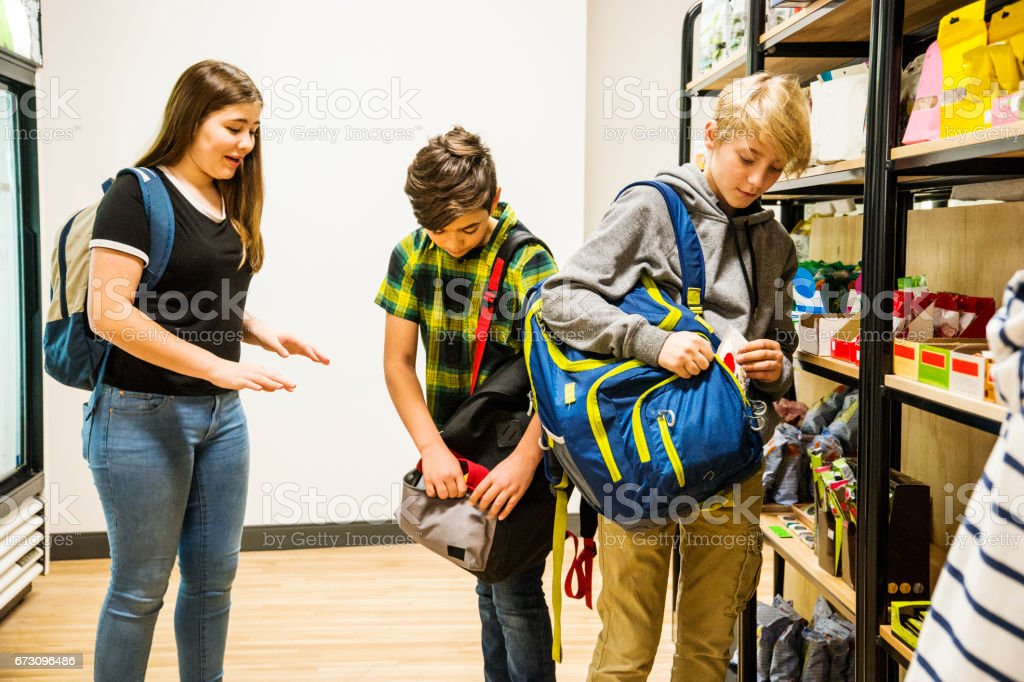 Children Stealing Candy In A Supermarket Stock Photo ...