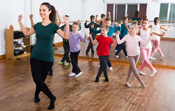 children studying contemp dance - dance class stock photos and pictures