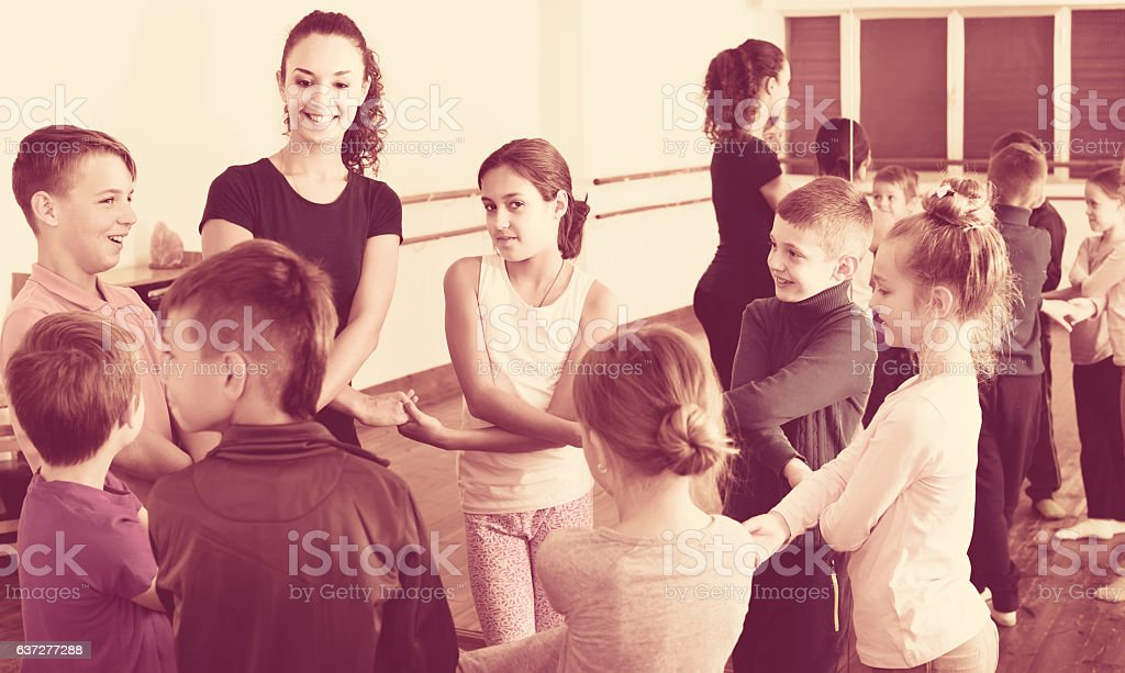 children  studying folk style dance in class - Photo