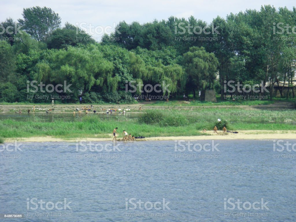 children swimming at the Yalu River, North Korea stock photo