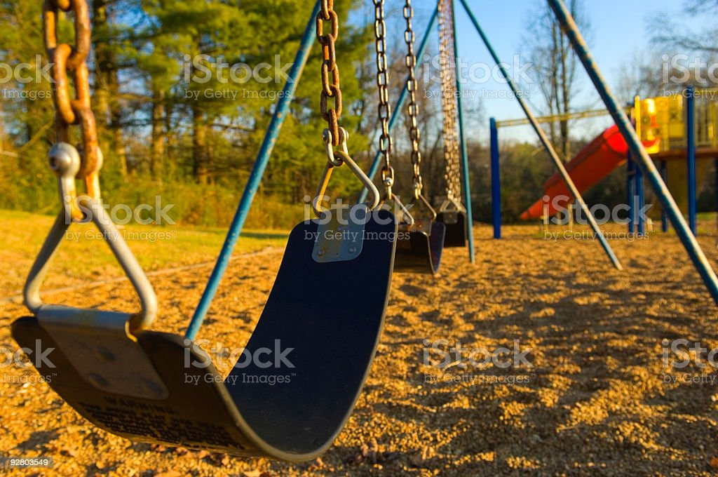 Children Swing-set at Playground At School or Park royalty-free stock photo
