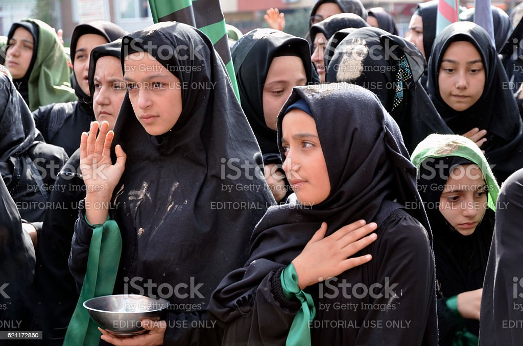 Children takes part in Ashura ceremony stock photo