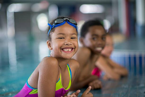 Children Taking Swimming Lessons stock photo