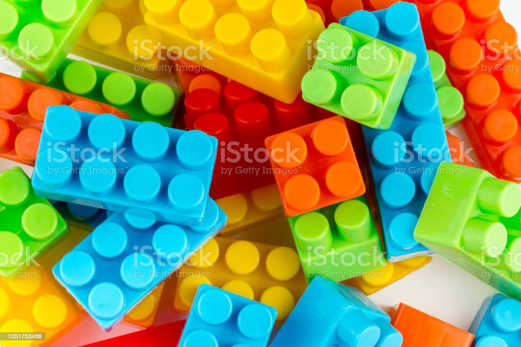 Children toys; colorful plastic blocks on the white background.