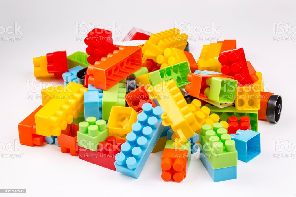 Children toys; colorful plastic blocks on the white background