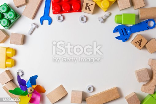 istock Children toys on white background as frame with copy space 639936330