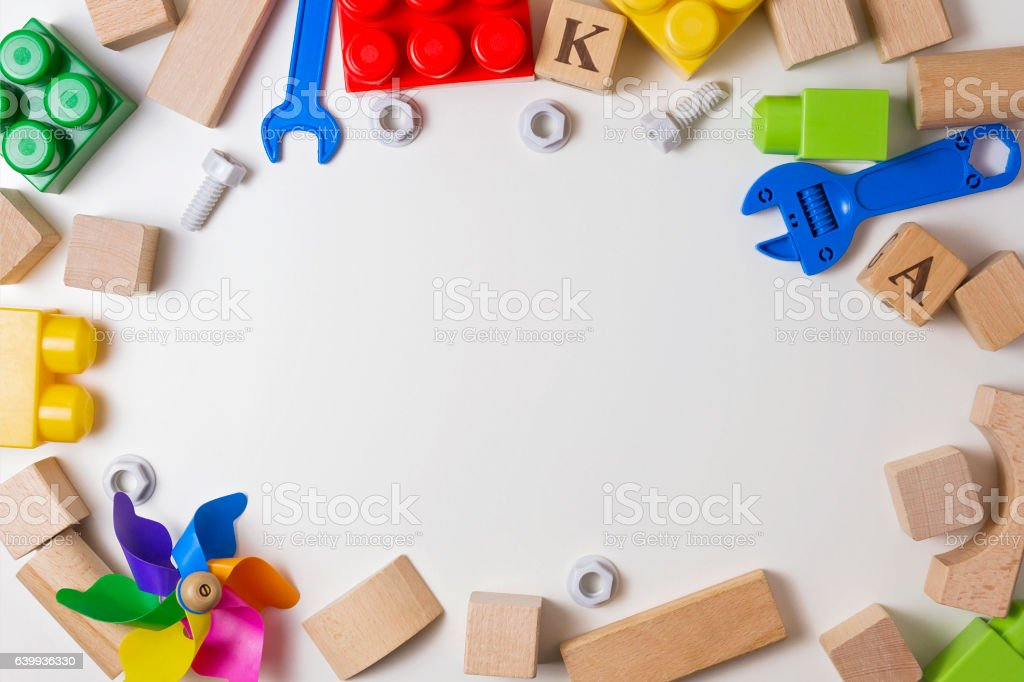 Children toys on white background as frame with copy space stock photo