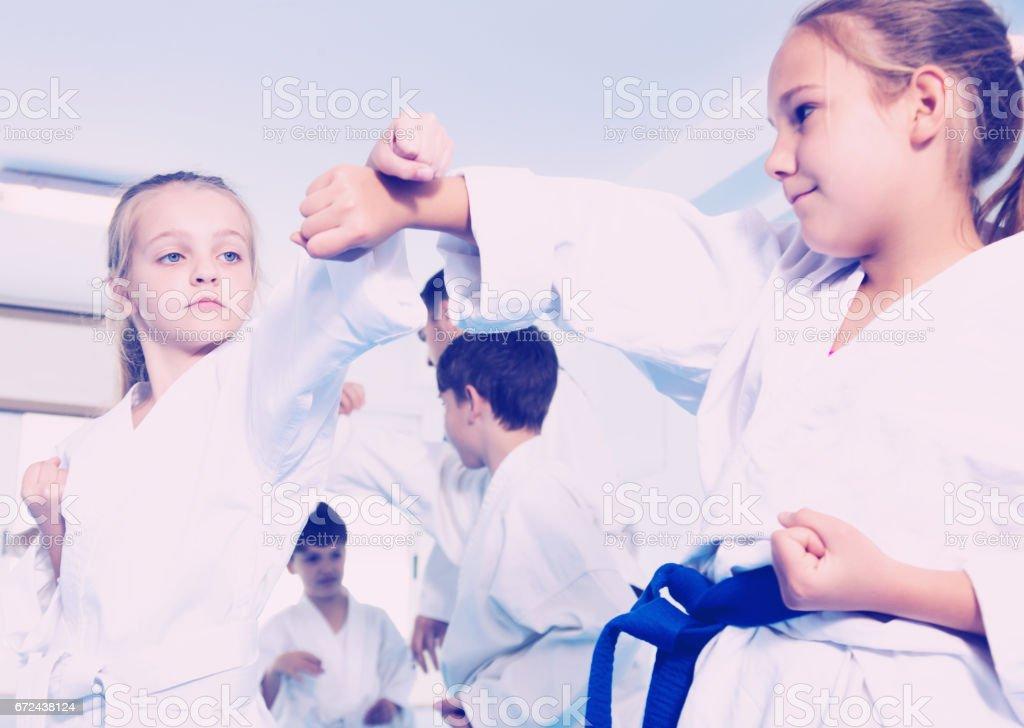 Children training in pairs stock photo