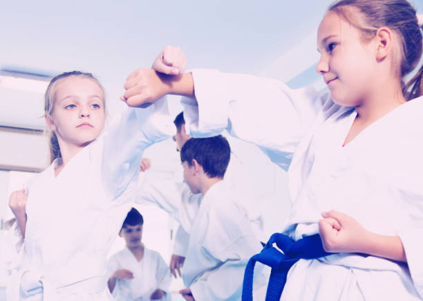 children training in pairs - martial arts stock photos and pictures