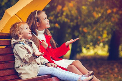 Children under umbrella