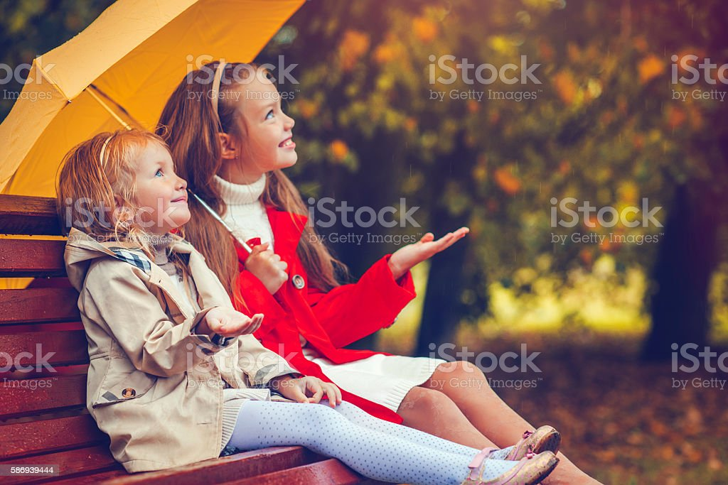 Children under umbrella stock photo