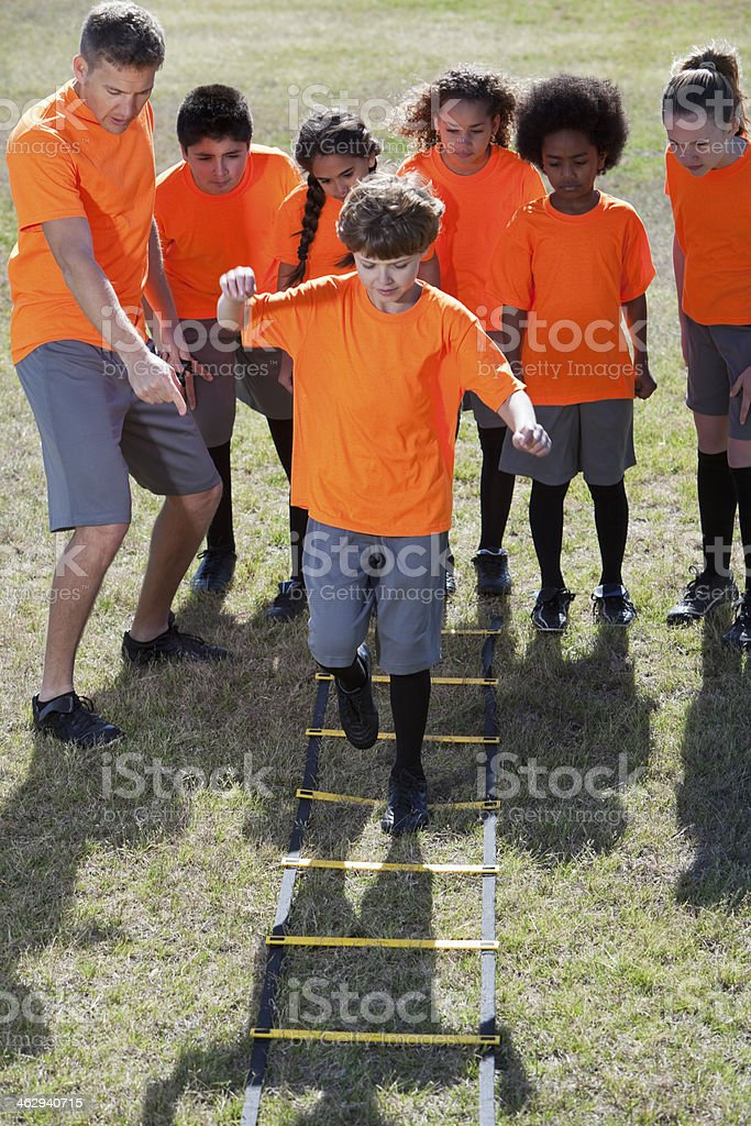 Children using agility ladder stock photo