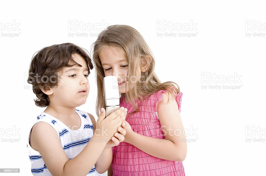 Children using cellphone royalty-free stock photo