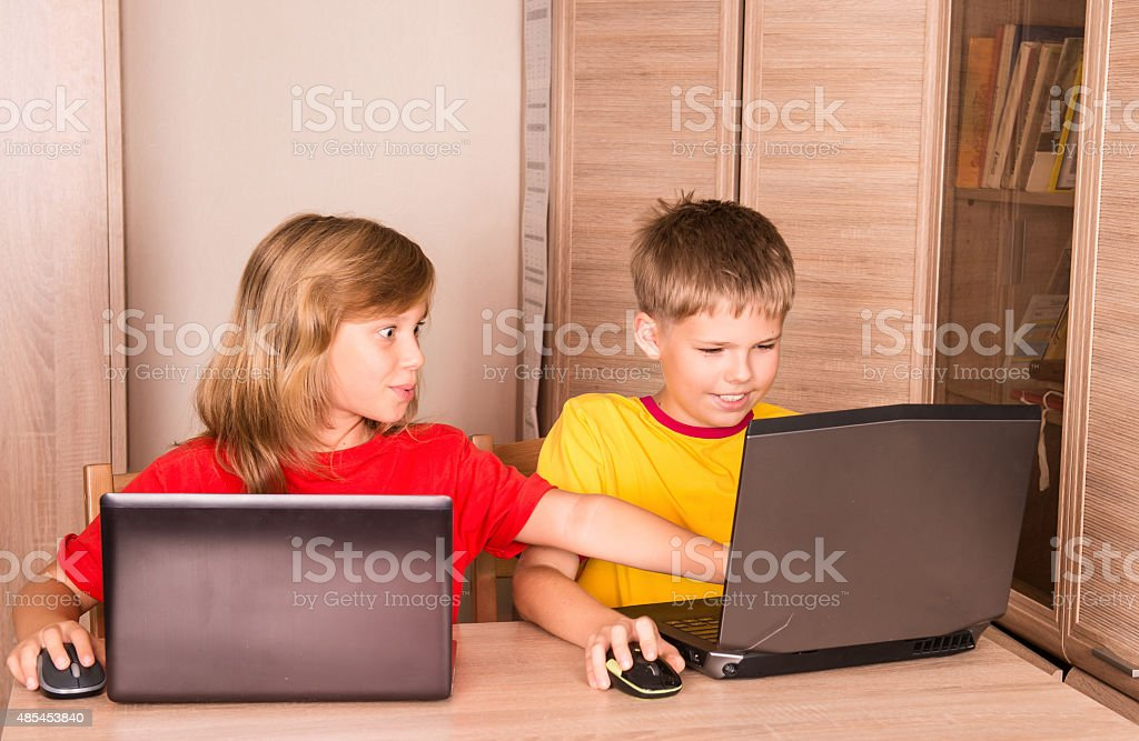 children-using-laptops-at-home-education-school-technology-internet-picture-id485453840?profile=RESIZE_400x