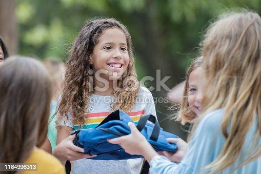 Children volunteering at school supply donation drive at elementary school