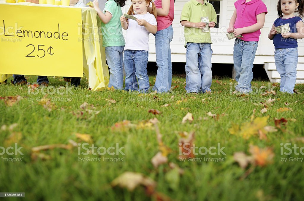 Children Waiting in Line at a Lemonade Stand royalty-free stock photo