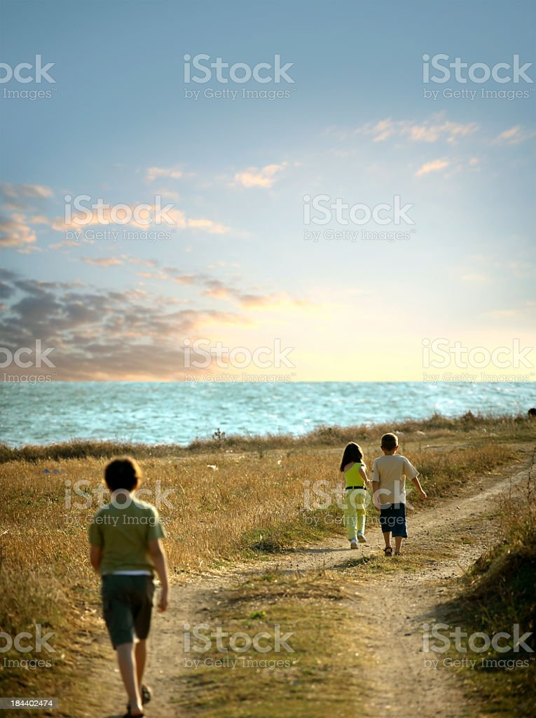children walking on dirt road royalty-free stock photo