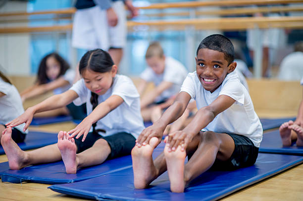 Children Warming Up in Gym Class stock photo