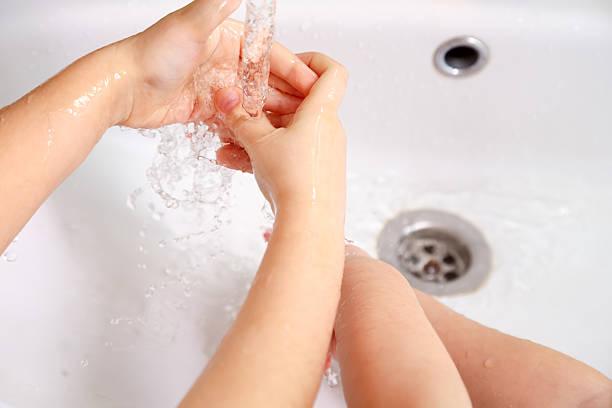 Children washing hands stock photo