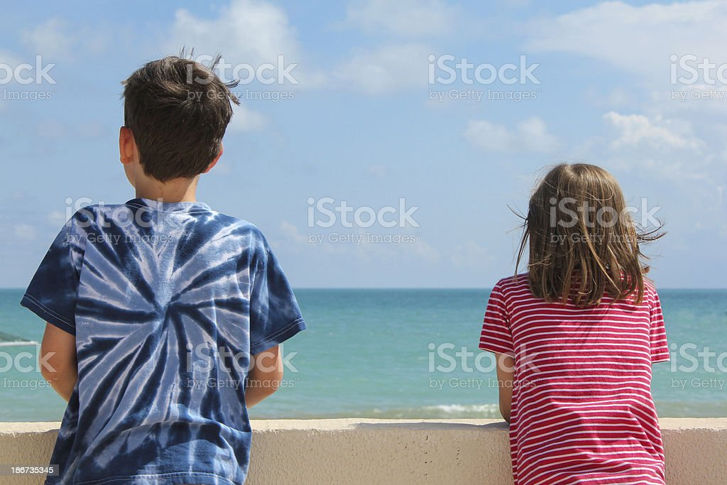 Children watching the beach royalty-free stock photo