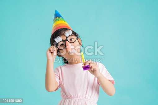 1016084100istockphoto Children wearing clothes and masks. to go to a party 1211991080