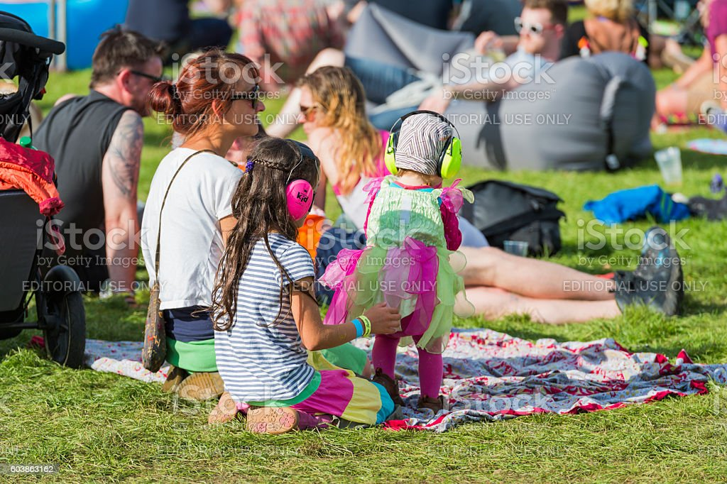Children wearing ear defenders at a music festival in Scotland stock photo