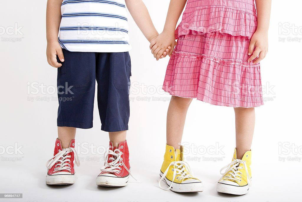 Children wearing oversized shoes stock photo
