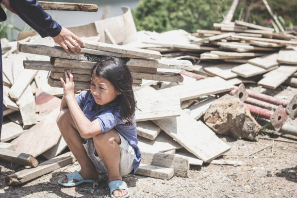 Children who work hard on the construction site, child labor , World Day Against Child Labour concept. Children who work hard on the construction site, child labor , World Day Against Child Labour concept. trafficking stock pictures, royalty-free photos & images