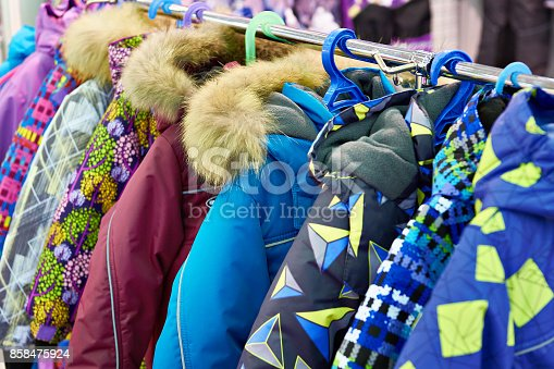 Children winter jackets on a hanger in the store