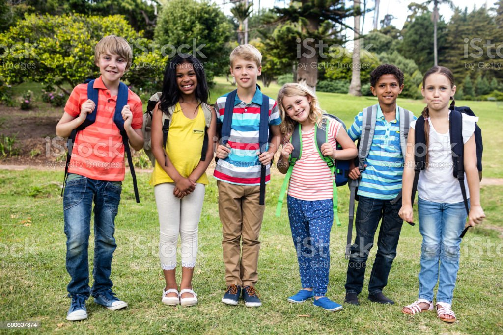 Children with bags standing together royalty-free stock photo