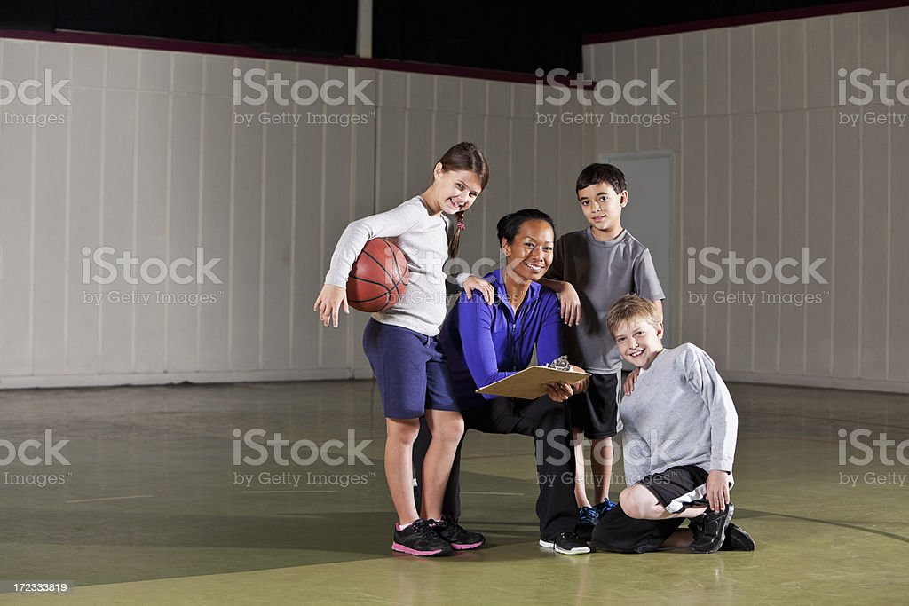 Children with basketball coach royalty-free stock photo