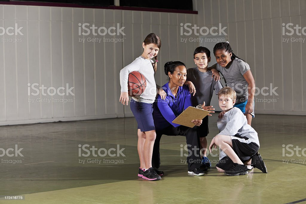 Children with basketball coach stock photo