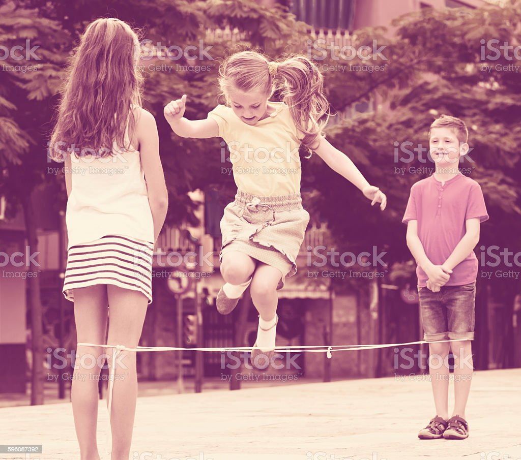 children with chinese jumping rope royalty-free stock photo