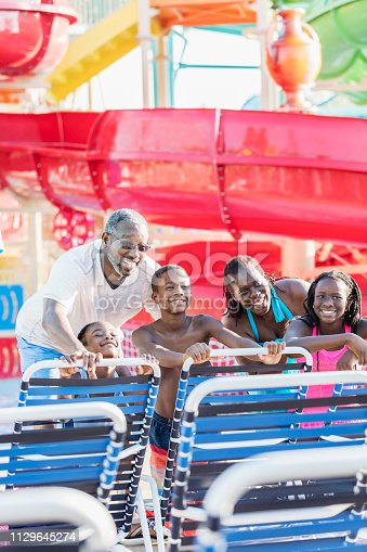 istock Children with grandparents at water park 1129645274