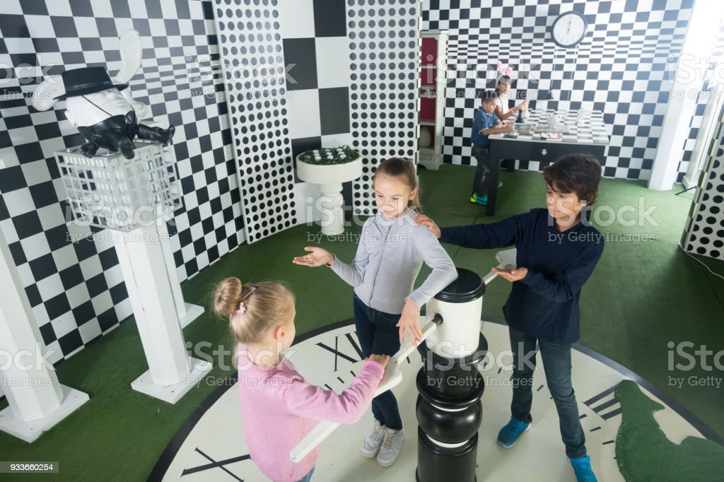 children with interest play in  chess  quest room stock photo