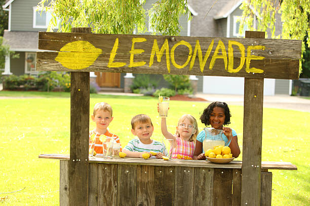 Children with lemonade stand Children with lemonade stand lemonade stand stock pictures, royalty-free photos & images