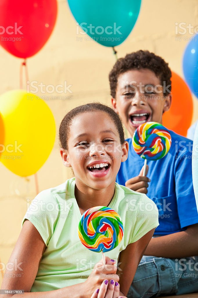 Children with lollipops and balloons stock photo