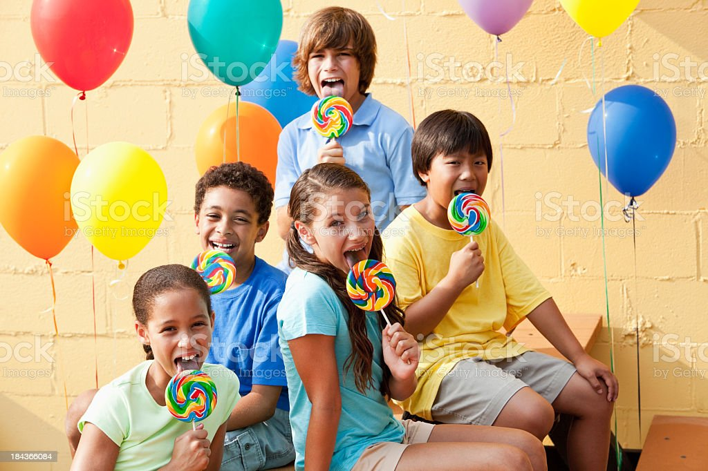 Children with lollipops and balloons royalty-free stock photo