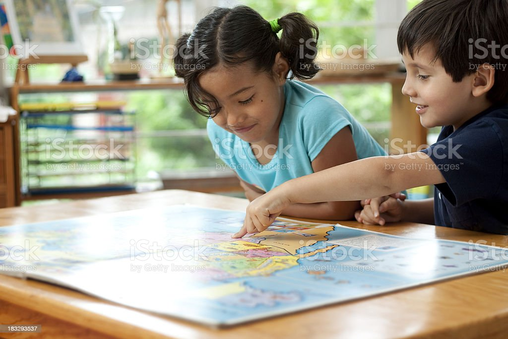 Children with map book at school stock photo