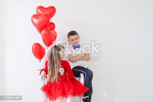 istock Children with red heart-shaped balloons at the holiday 1225511907
